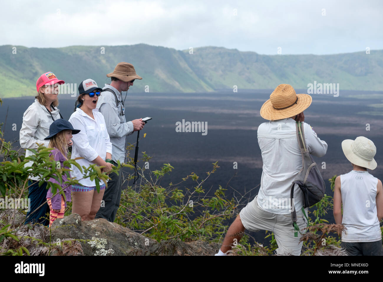 Guide yelling to create an echo on the rim of the Sierra Negra volcano on Isabela Island, Galapagos Islands, Ecuador. - Stock Image