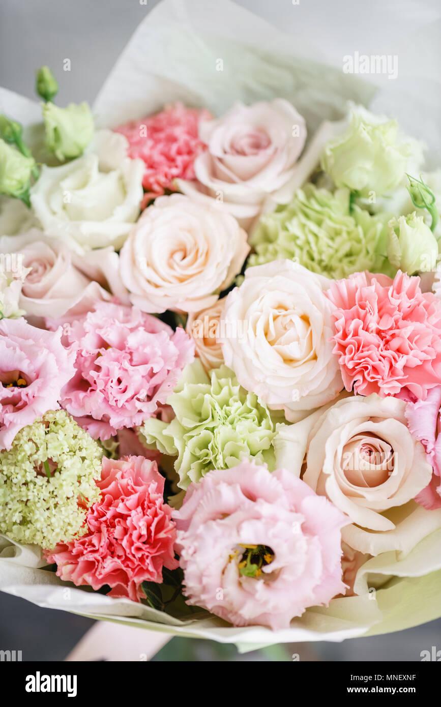 Flower arrangement multicolor bouquet of beautiful flowers on flower arrangement multicolor bouquet of beautiful flowers on wooden table floristry concept spring colors vertical photo izmirmasajfo