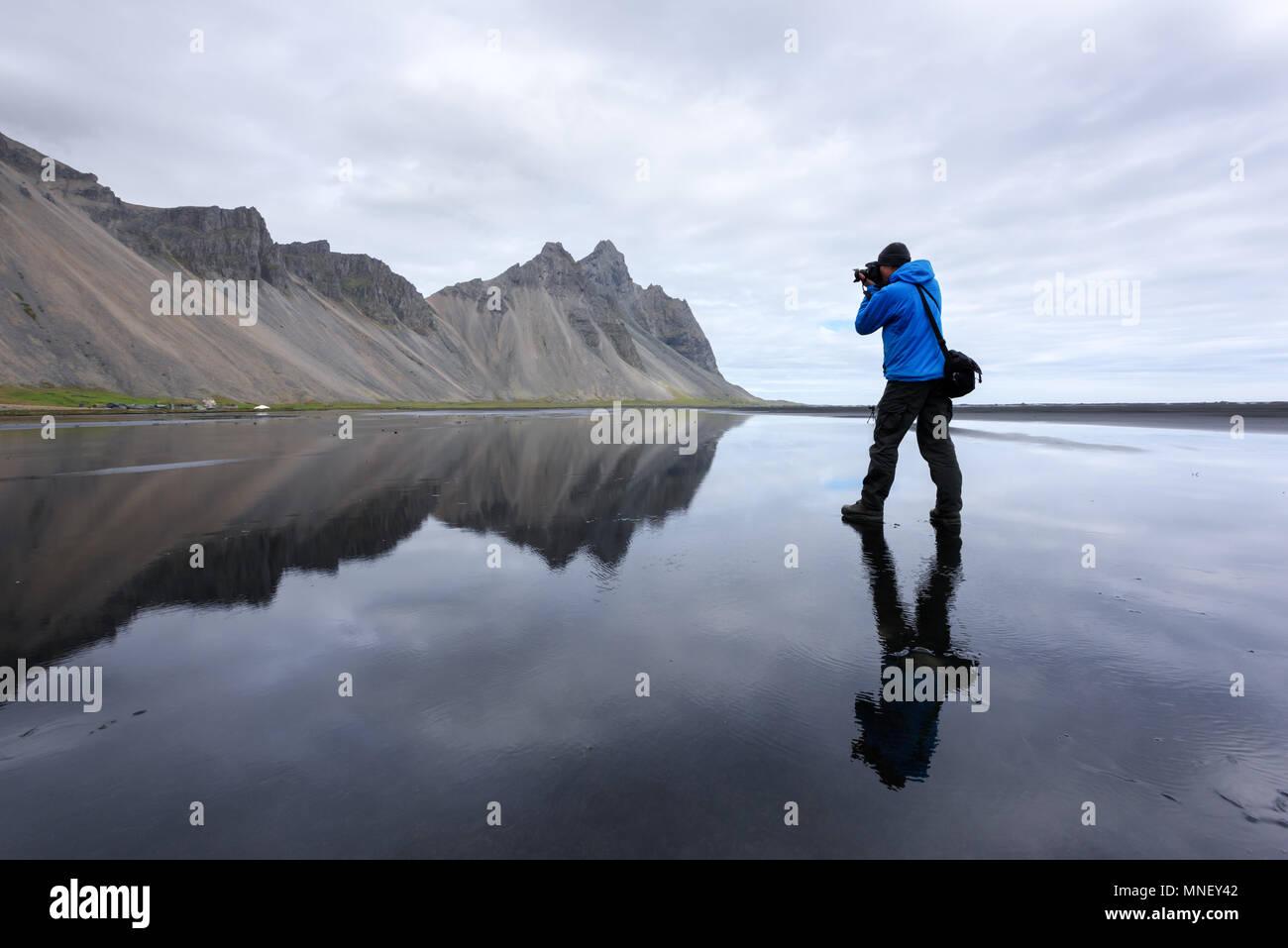 Photographer take photo near famous Stokksnes mountains - Stock Image