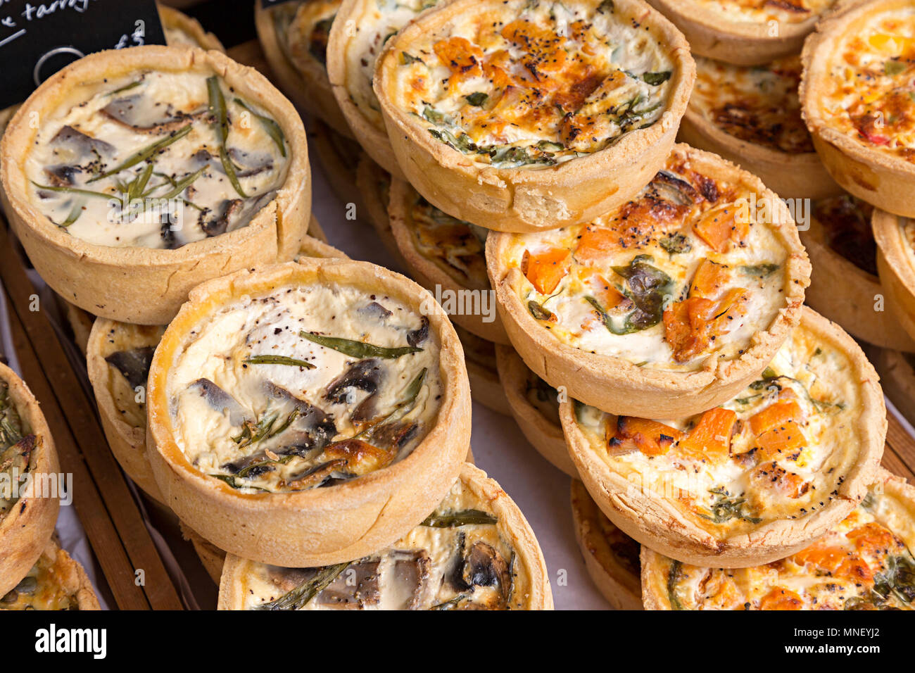 Artisan mushroom and cheese and butternut squash and cheese vegetarian pies on sale at Abergavenny Food Festival, Wales, UK - Stock Image