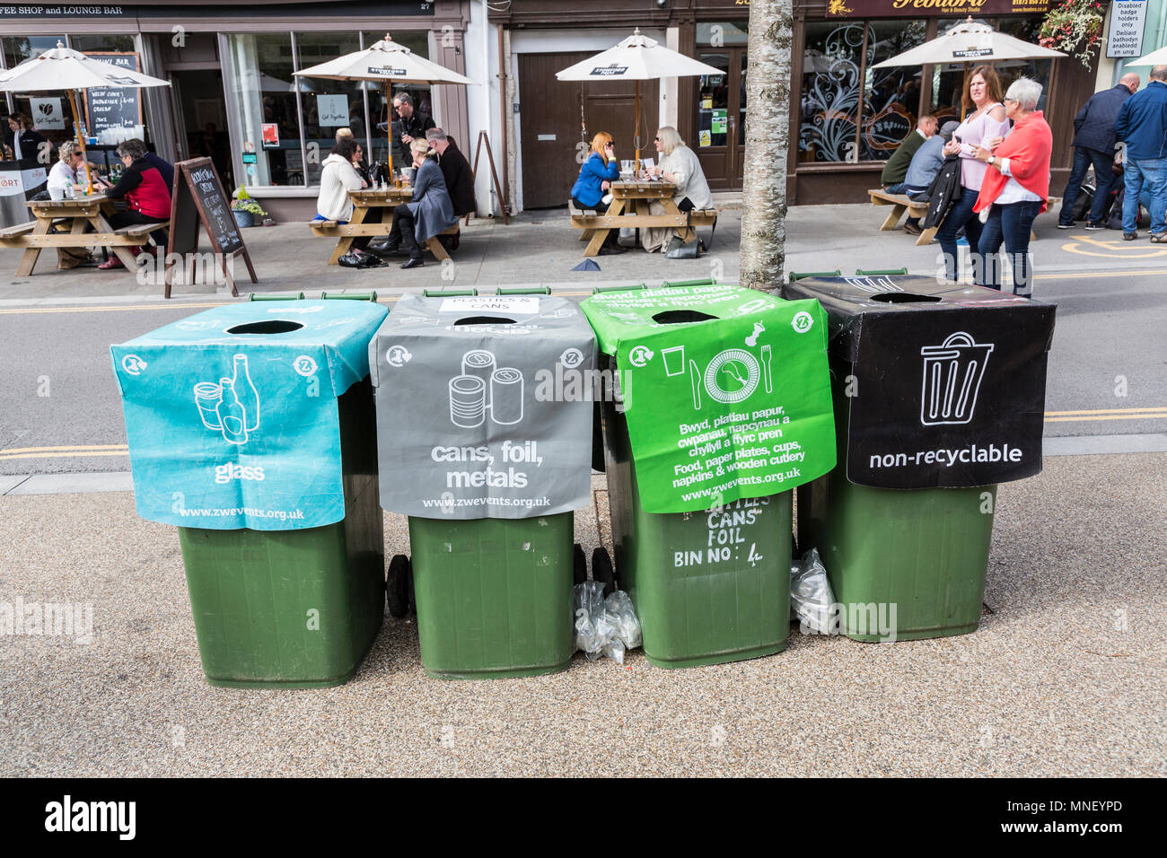 Recycling and litter bins in street at food festival, Abergavenny, Wales, UK - Stock Image