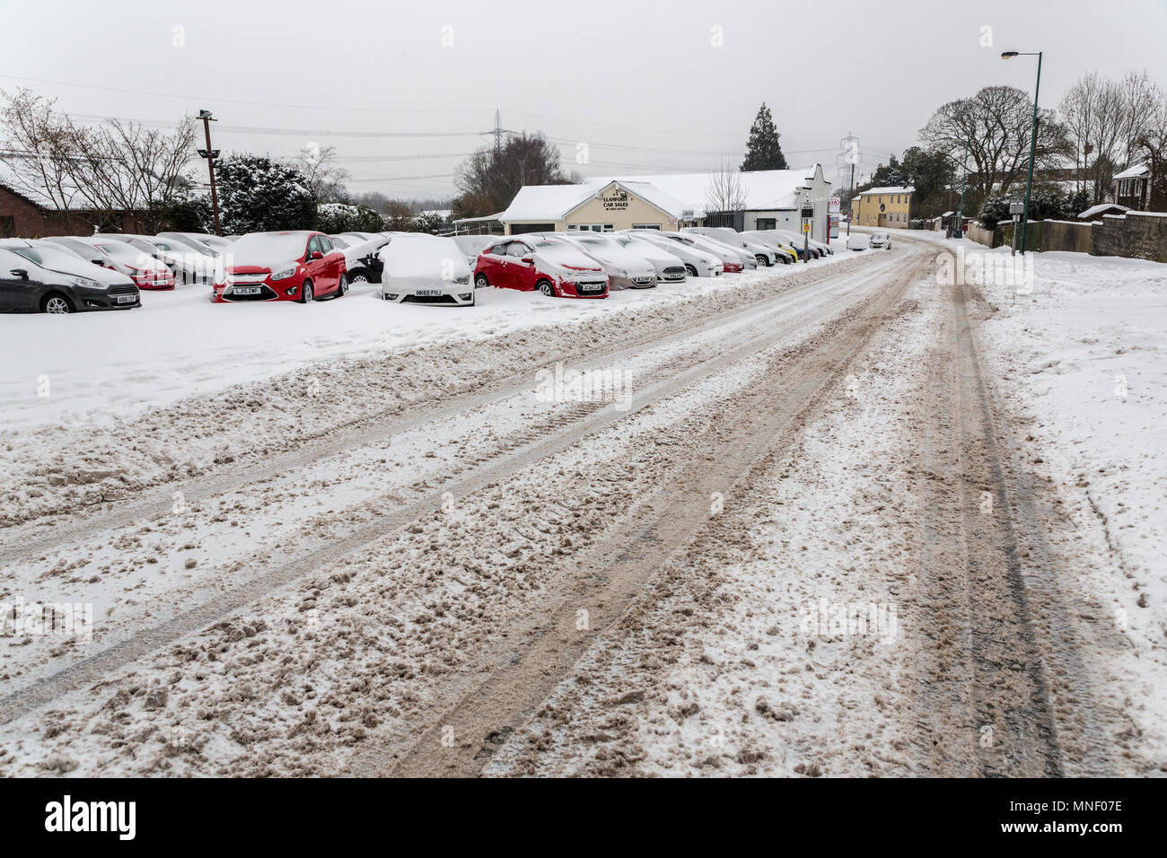 Slush in road that has been salted in winter, Llanfoist, UK - Stock Image