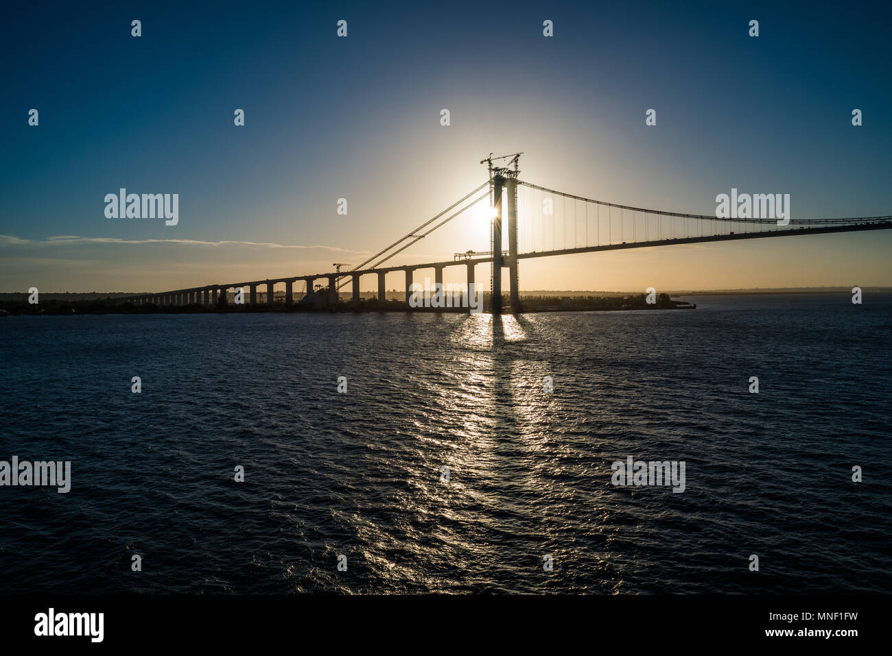 Sundown shot of a bridge that crosses the Mozambique Channel at Maputo. - Stock Image