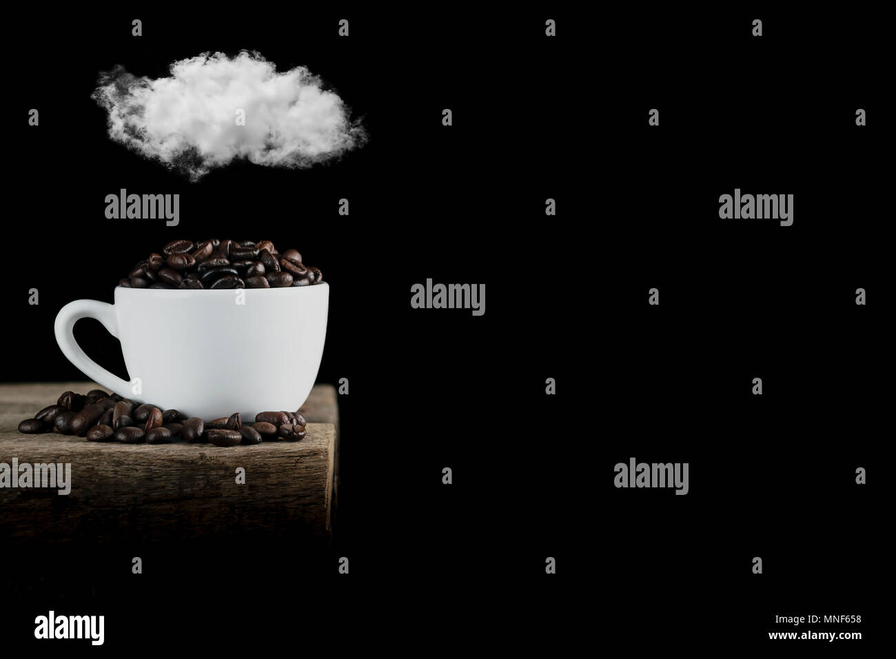 close up coffee beans in cup,top clound - Stock Image