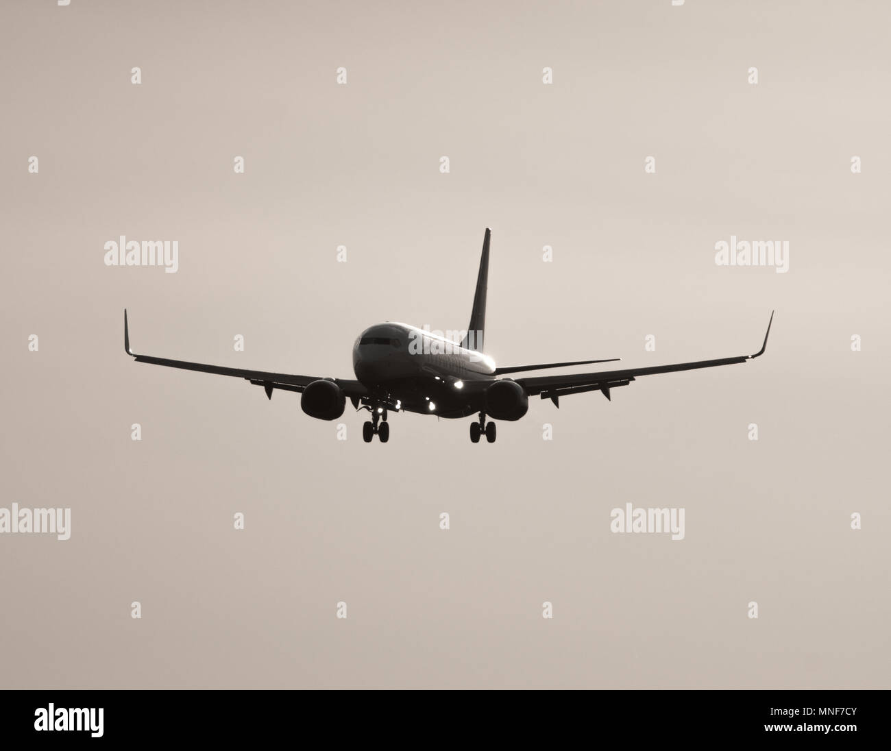 Jumbo jet high contrast landing - Stock Image