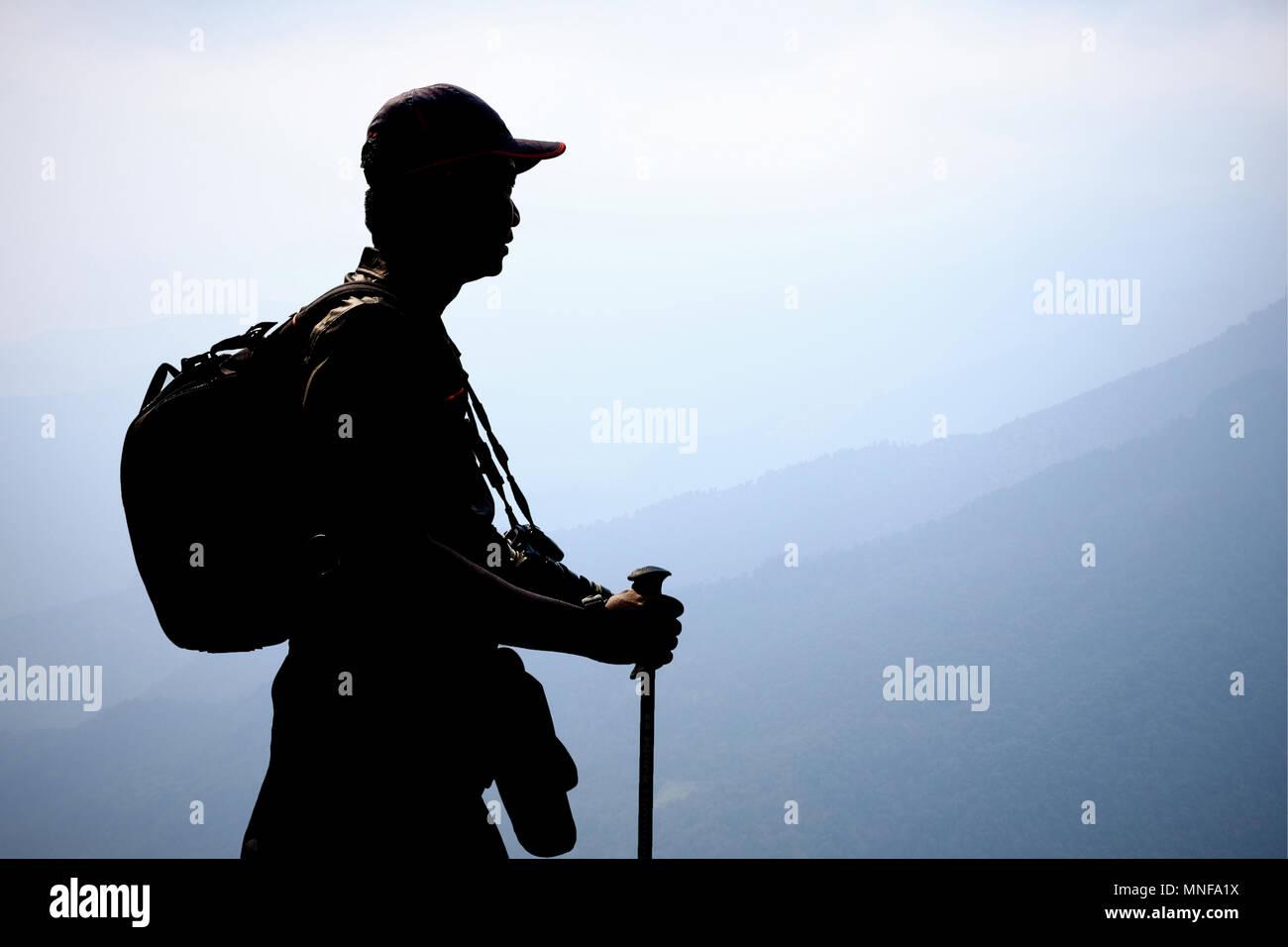 Silhouette trekker with backpack f934541ca299b
