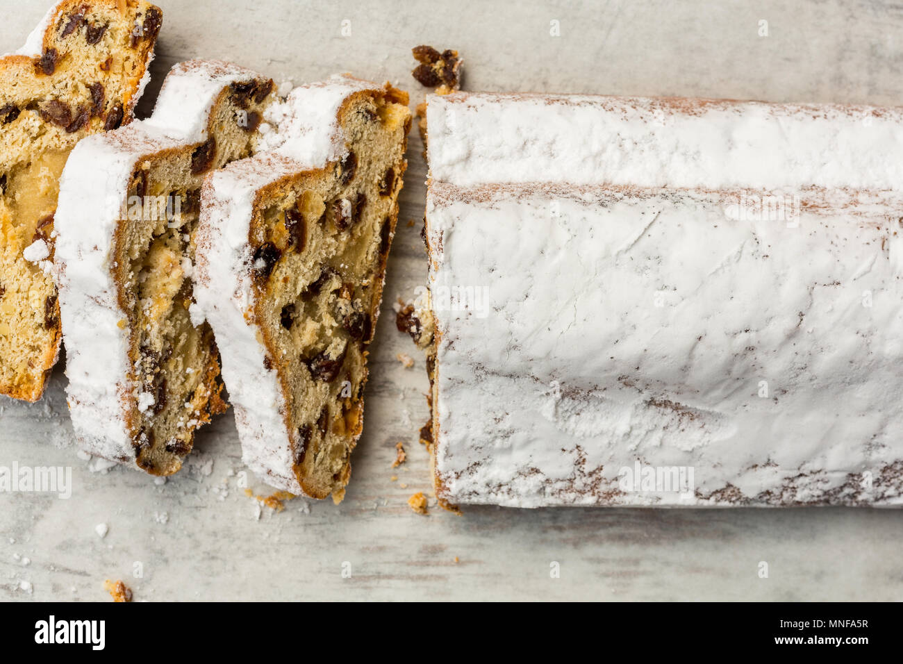 Traditional Christmas Stollen sliced - Stock Image