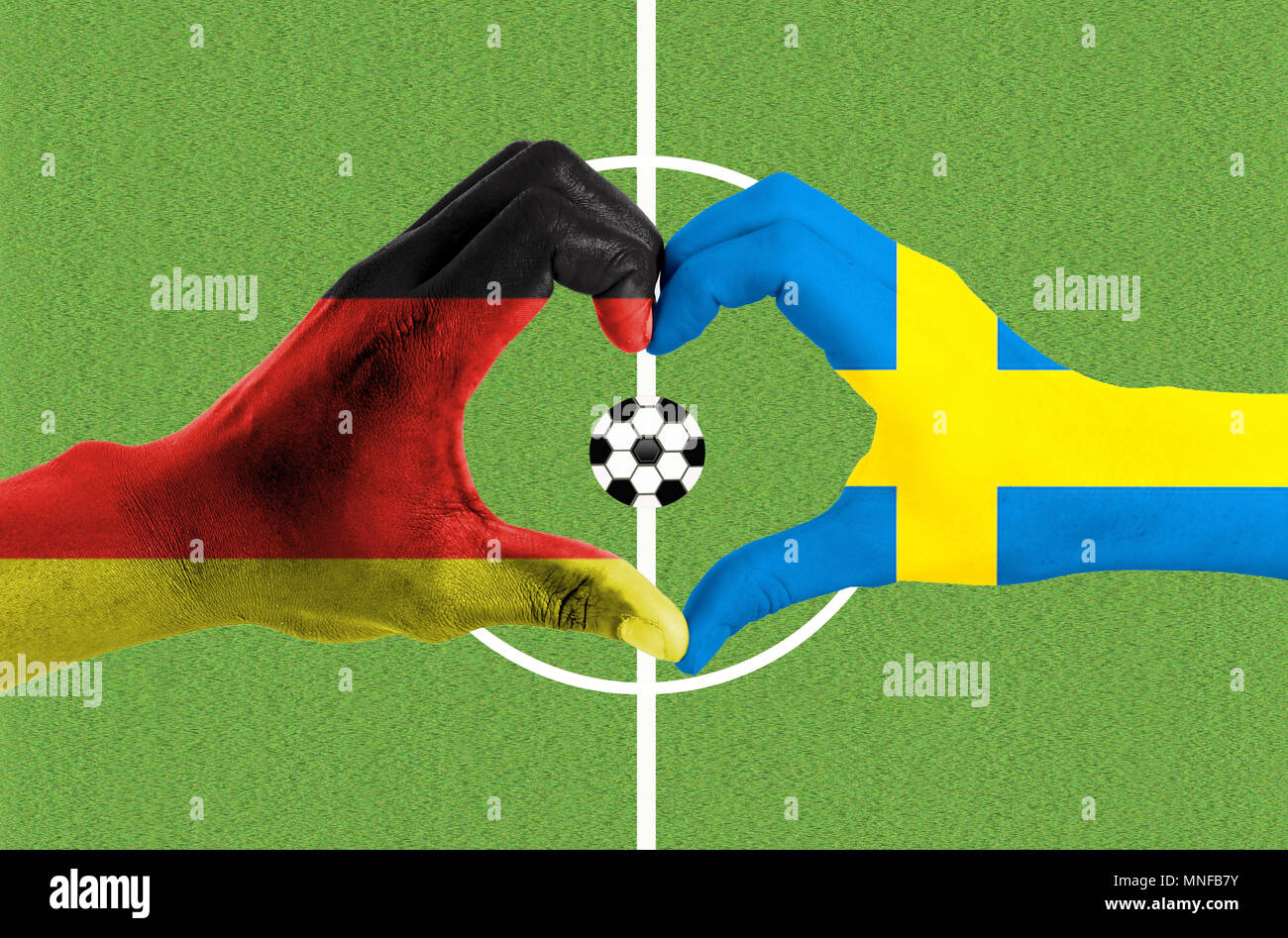 Hands painted in national flag forms love, Football game - Stock Image