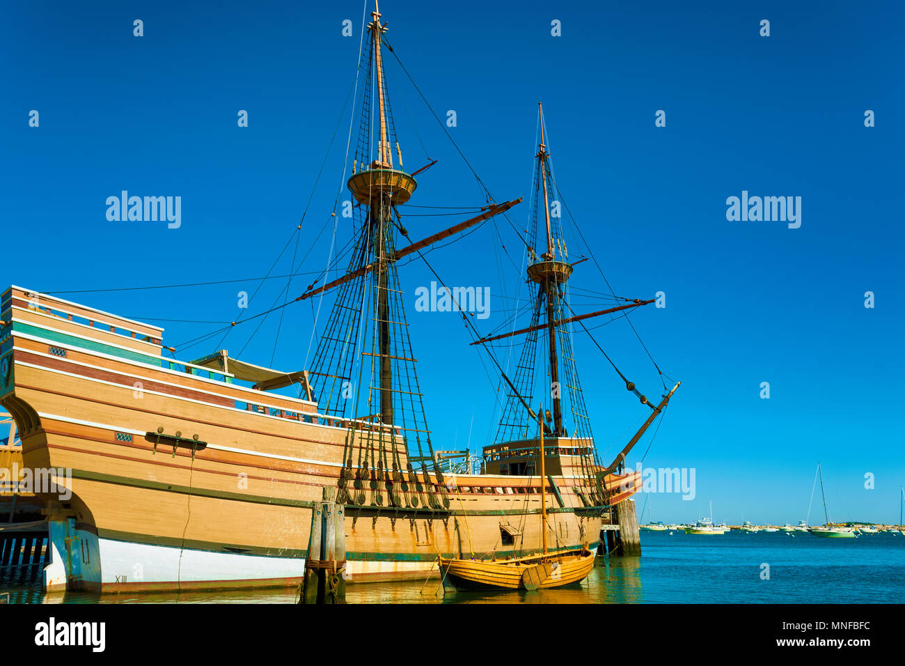 Plymouth, Massachusetts, USA - September 13, 2016:  The Mayflower II resides in the harbor, a replica of the 17th century Mayflower and it's dinghy. Stock Photo