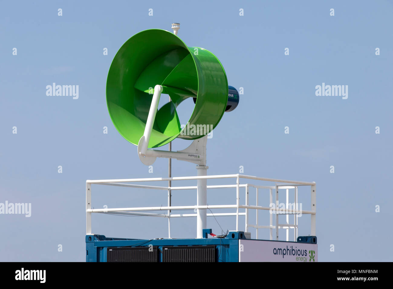 Mobile Energy Station Amphibious Energy, container that generates electricity on site with wind energy and solar panels, where it is needed, Port of R - Stock Image
