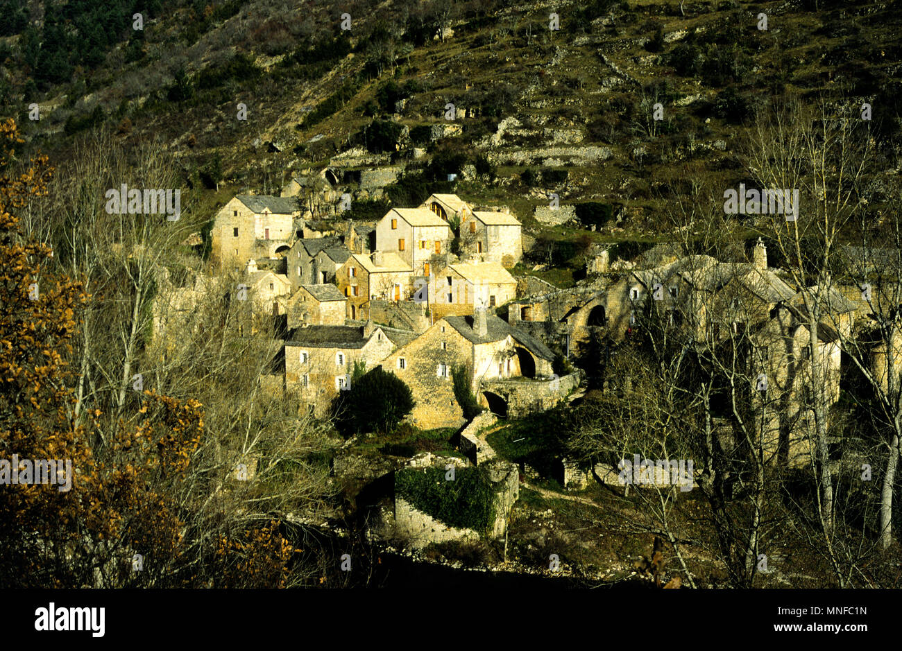 Stone Houses at Hauterives, on left bank of the Tarn River, Gorges du Tarn, Lozère,France - Stock Image