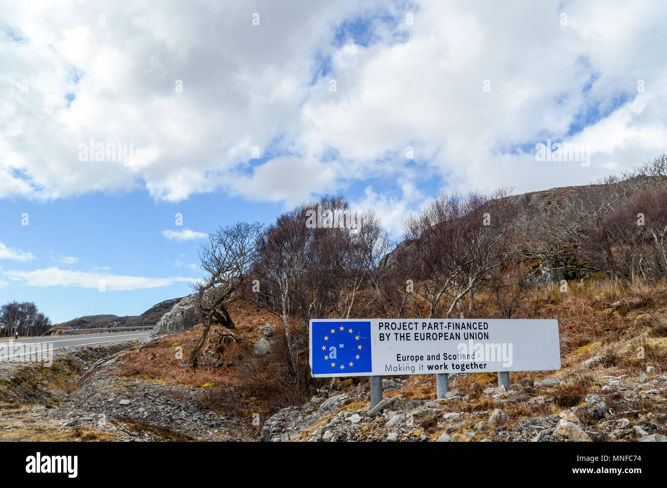 'Europe and Scotland' : Road sign in Highland, Scotland (Mallaig), highlighting the cooperation between Scotland and the European Union - Stock Image