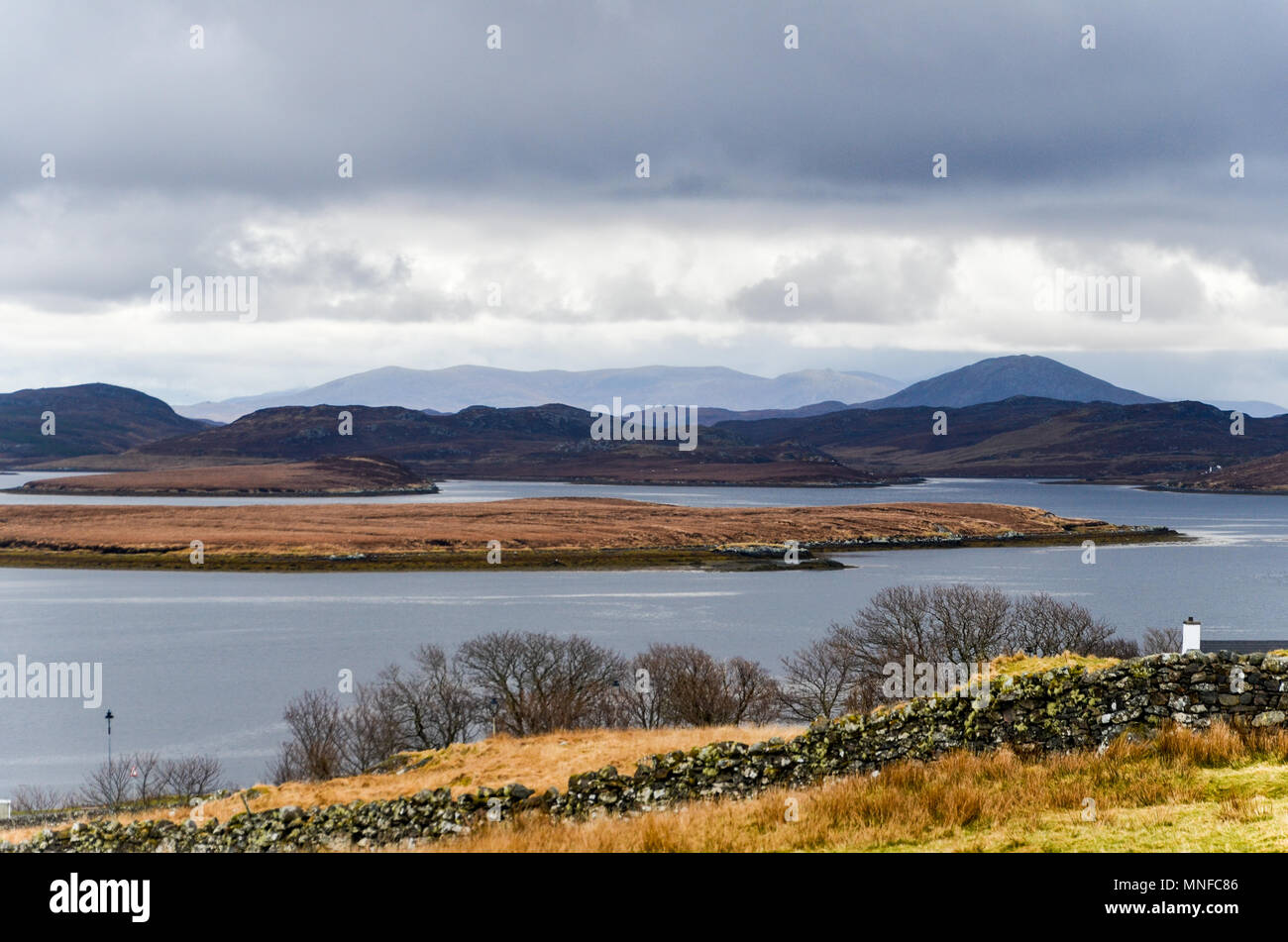 """Landscape in the Outer Hebrides near Callanish. Local people call her """"Sleeping Beauty"""" in English or """"Cailleach na Mointeach"""" in Gaelic. Stock Photo"""