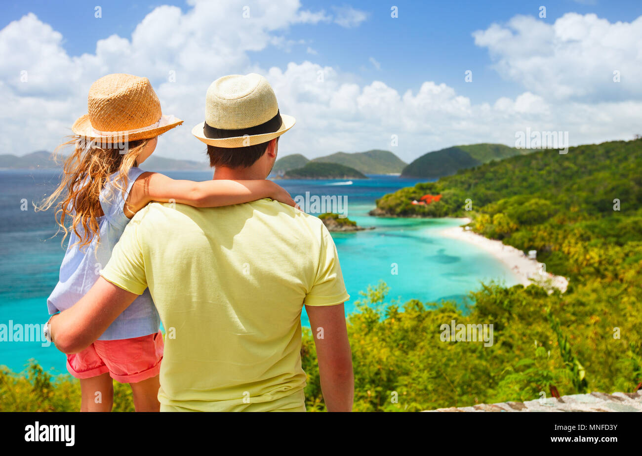 Family of father and daughter enjoying aerial view of picturesque Trunk bay on St John island Stock Photo
