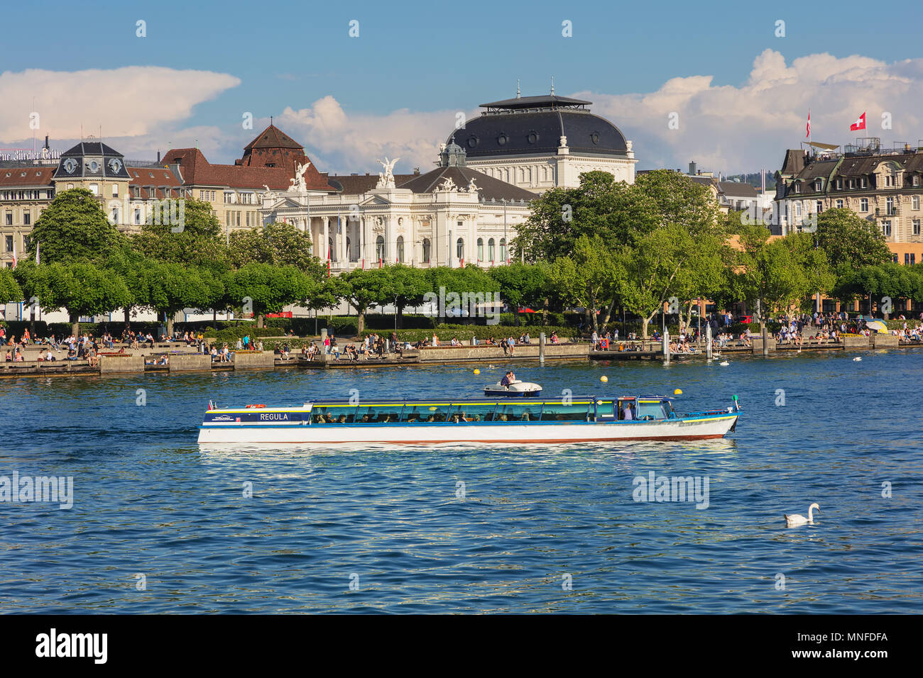 Zurich, Switzerland - May 11, 2018: embankment of Lake Zurich in the city of Zurich, building of the Zurich Opera House. Zurich is the largest city in - Stock Image