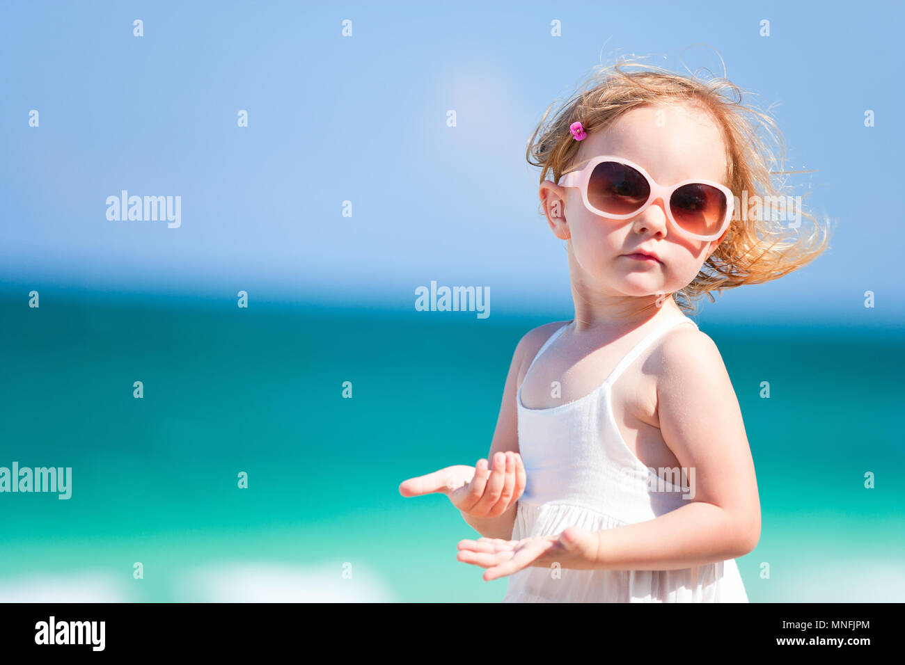 e18037a7c72 Portrait of cute little girl on beach vacation Stock Photo ...