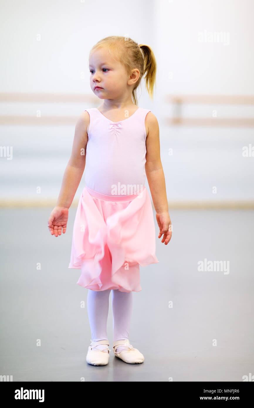 f218ac9f434504 Adorable little ballerina wearing pink leotard in a dancing school ...