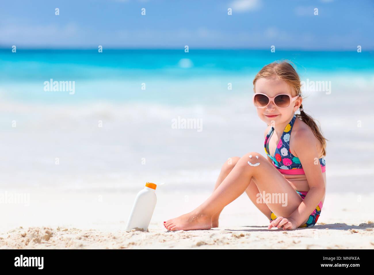 little girl sun little girl is sunbathing on a sunbed near the pool at the resort