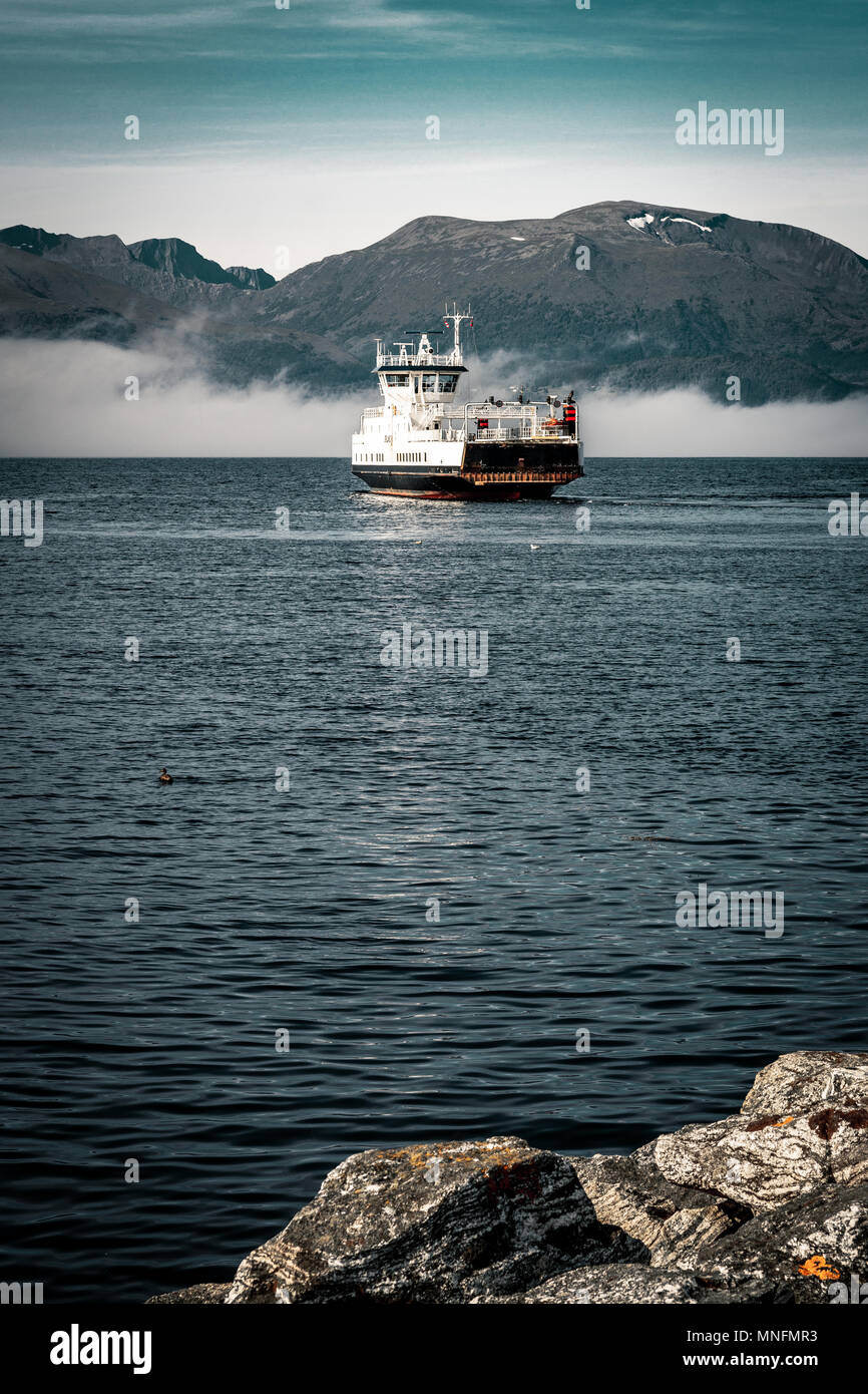 Norwegian Ferry on the Fjord in Volda, cearly morning (Folkestad, Alesund) - Stock Image