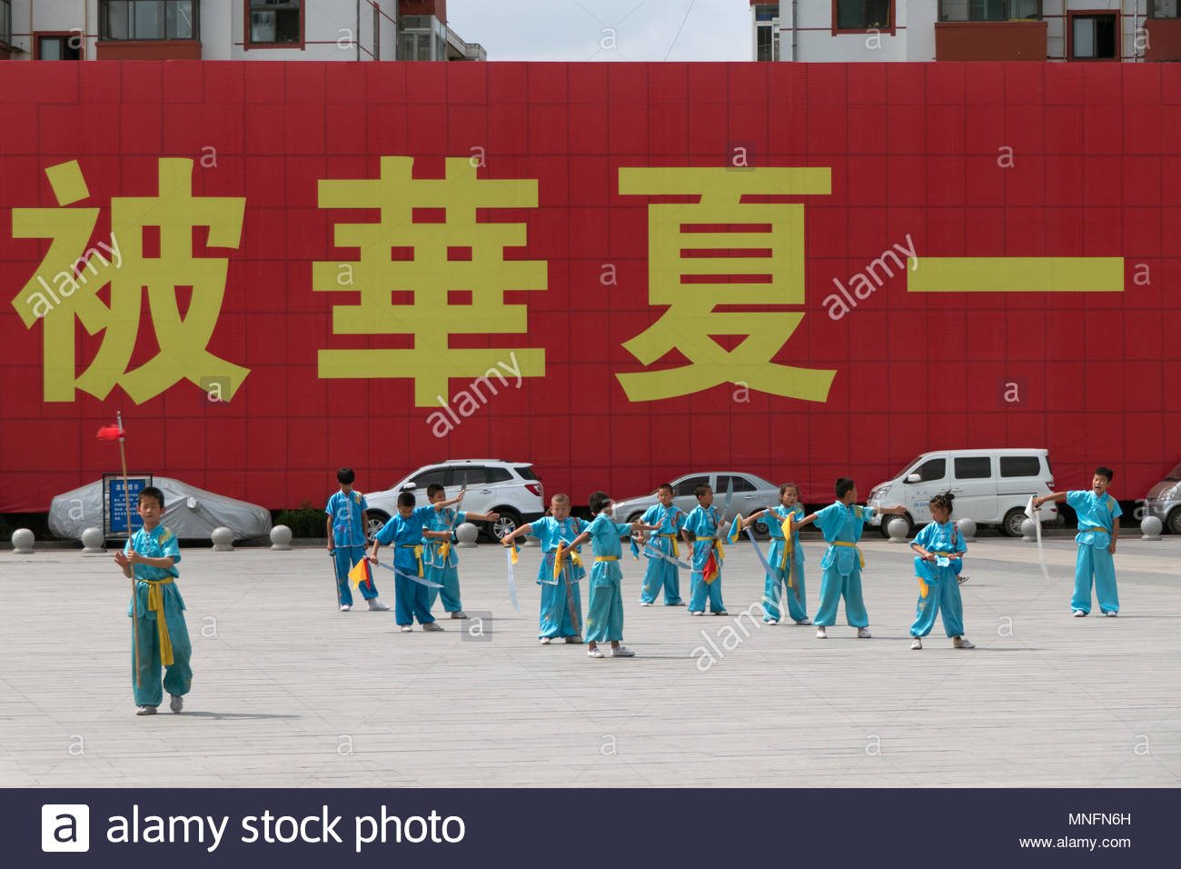 c9fe5e4a2 Young Chinese people training, child working out, boy exercising with sword  for traditional martial