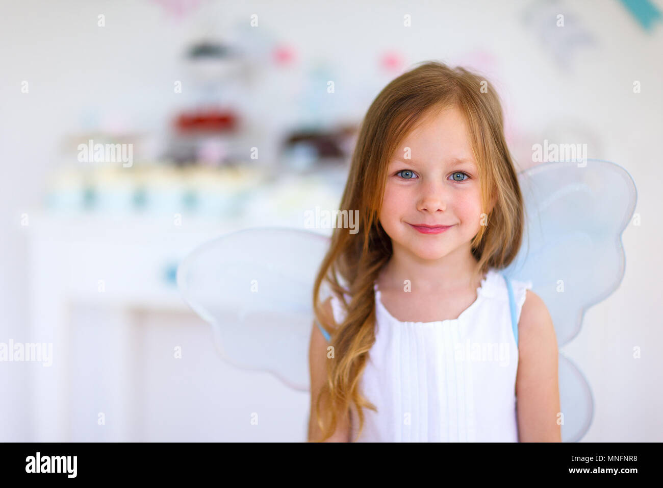 Adorable little fairy girl on a birthday party Stock Photo