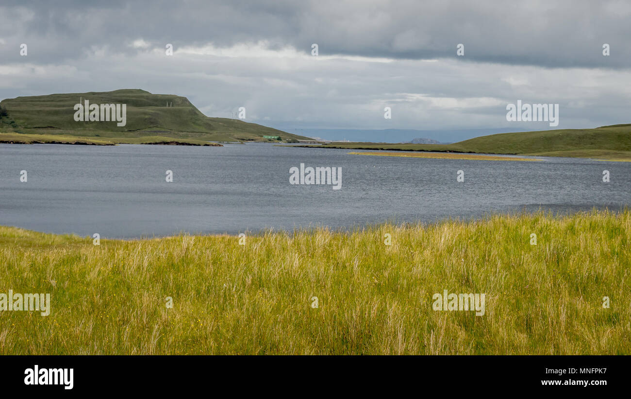 Loch leathan at the Isle of Skye with a dramatic cloudly sky in background, Scotland, UK - Stock Image