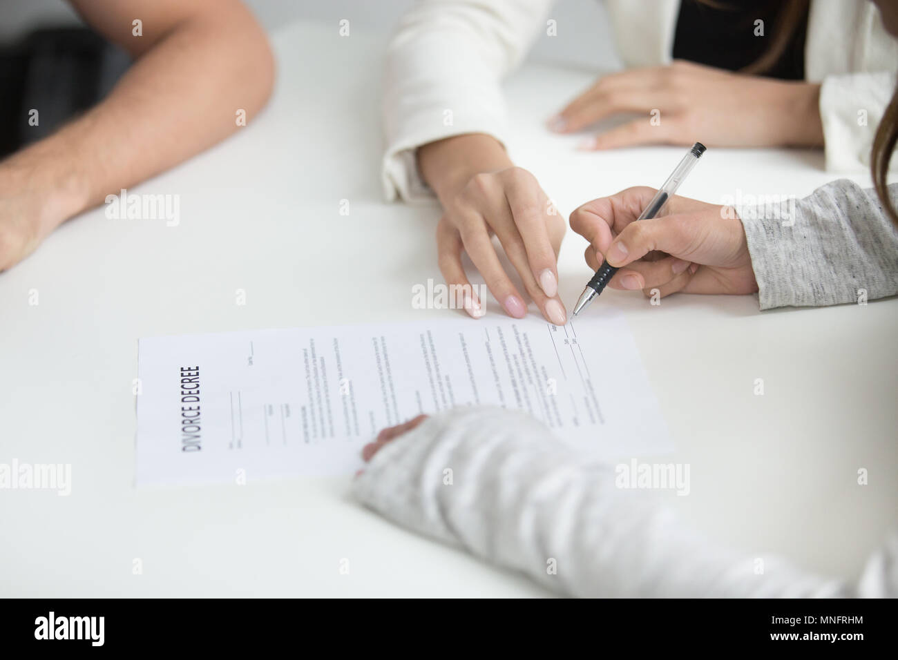 Wife signing divorce decree after break up decision - Stock Image