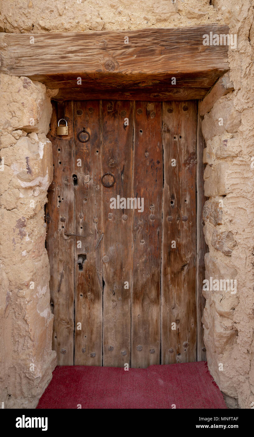 Wooden door leading to the fort of Monastery of Saint Paul the Anchorite located in the Eastern Desert, near the Red Sea mountains, Egypt - Stock Image