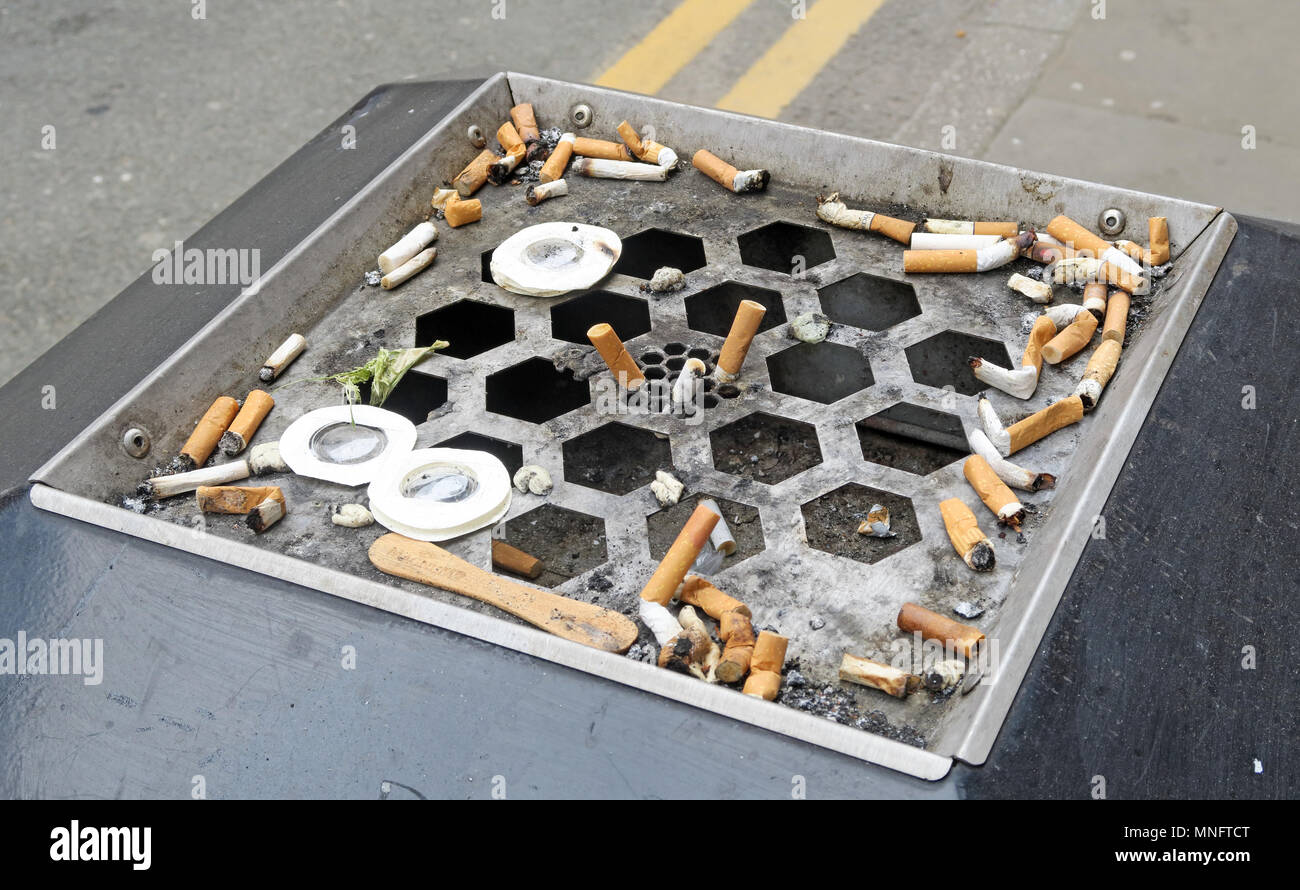 Cigarette butts, in a city street, Manchester, Lancs,England, UK - Stock Image
