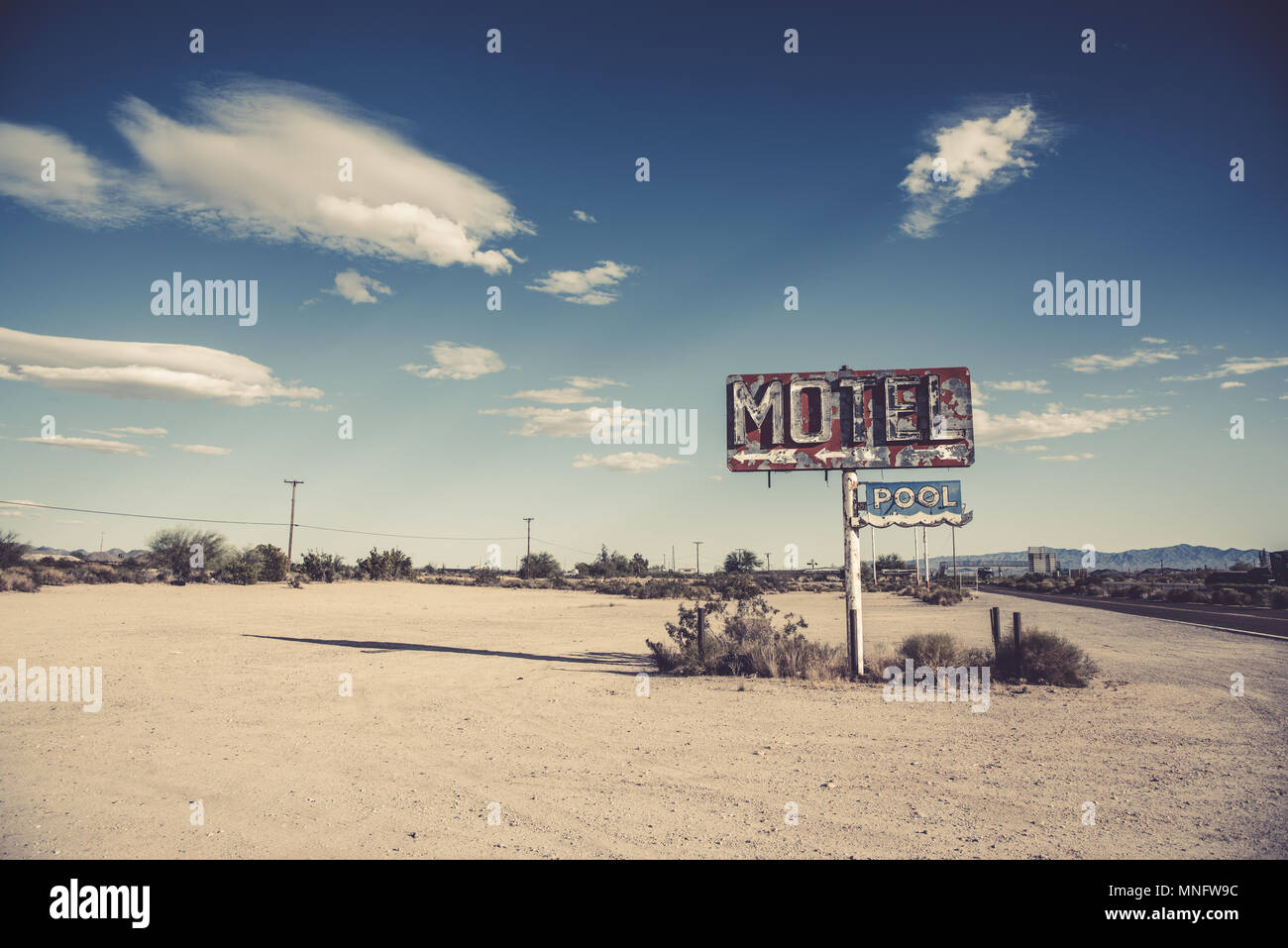 A dilapidated, vintage motel sign in the desert of Arizona - Stock Image