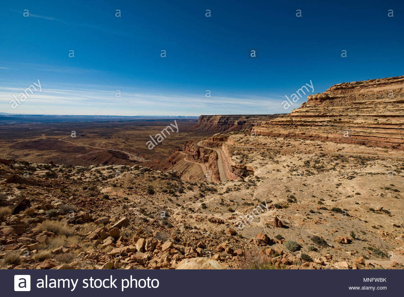 Moki Dugway primitive road, part of Utah State Route 261 twist and turns up Cedar Mesa from the Valley of the Gods 1,200 feet below, San Juan County,  - Stock Image