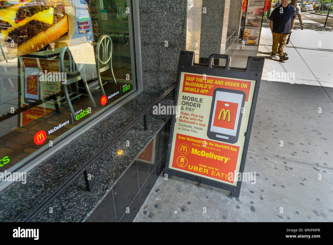 A McDonald's restaurant in New York displays signage promoting their