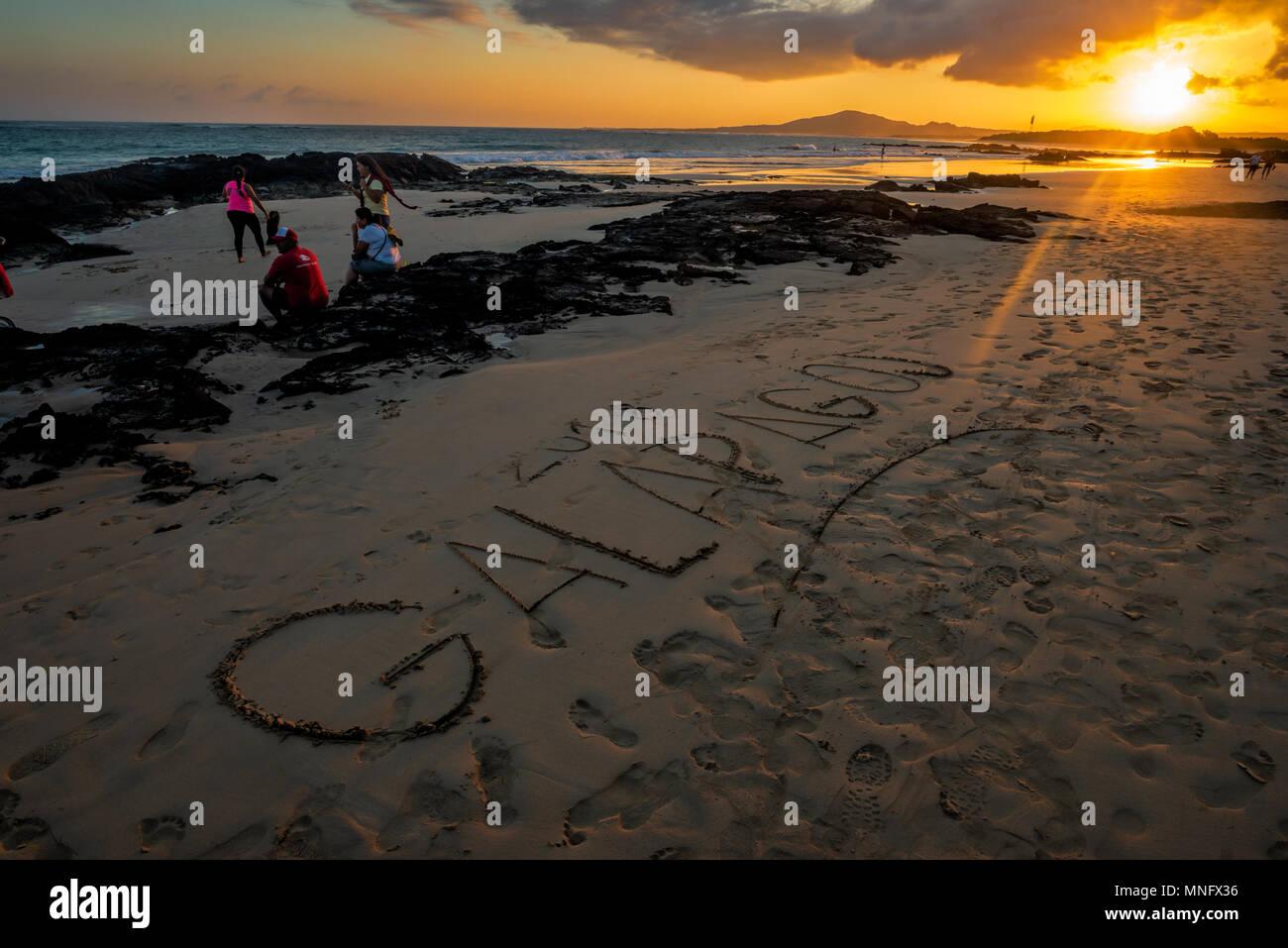 '2018 Galapagos' written in the sand of the beach at Puerto Villamil, Isabela Island, Galapagos Islands, Ecuador. - Stock Image