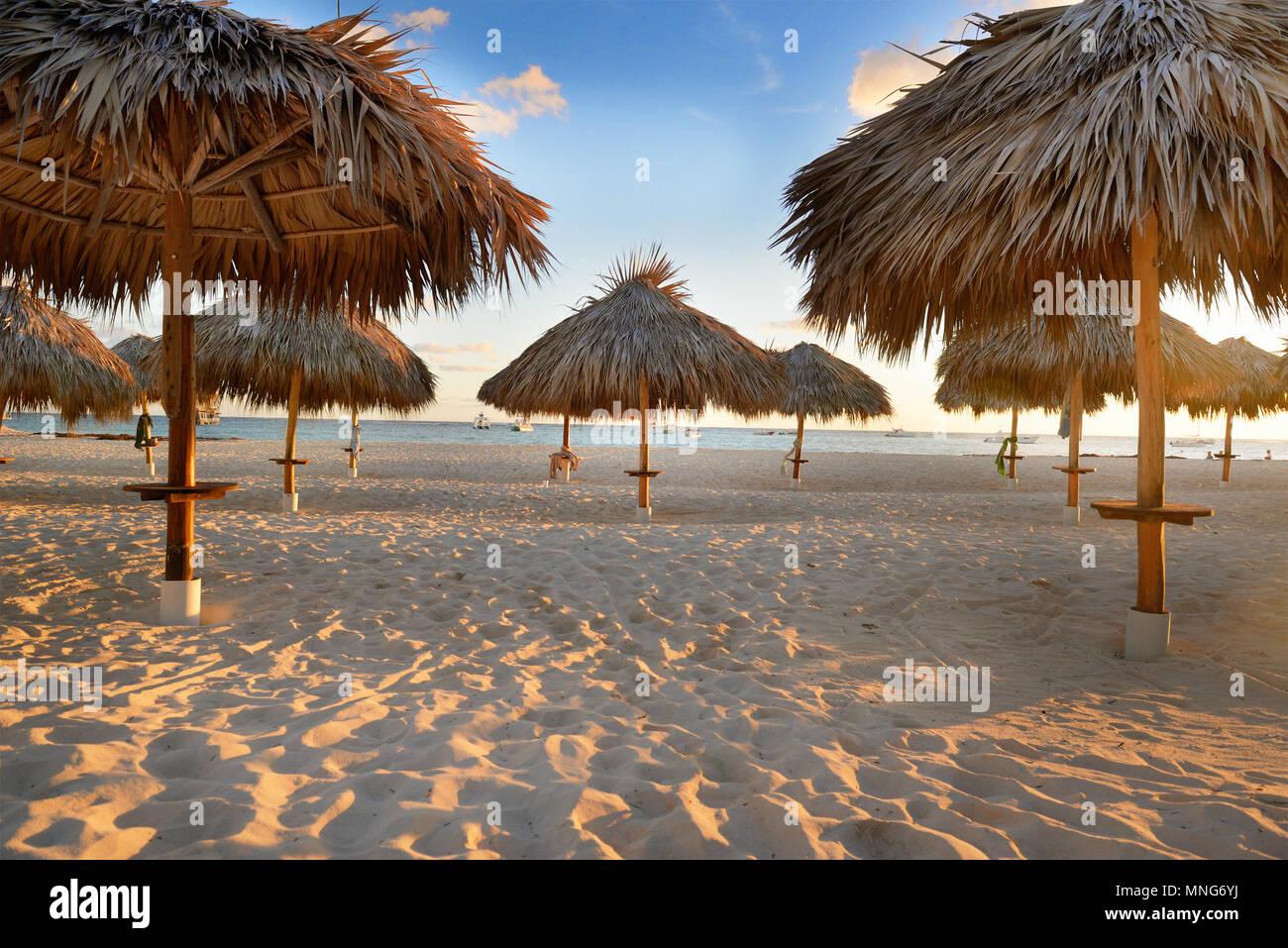 Amazing tropical holidays. Sun umbrellas on the beach. Tropical paradise. Caribbean. Punta Cana. Dominican Republic - Stock Image