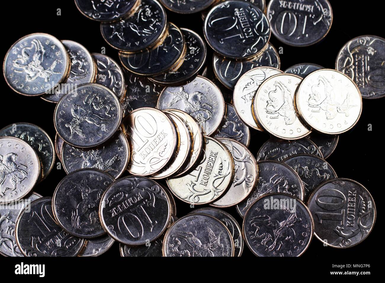 A close up of a pile of brass Russian ten kopek coins in a pile - Stock Image