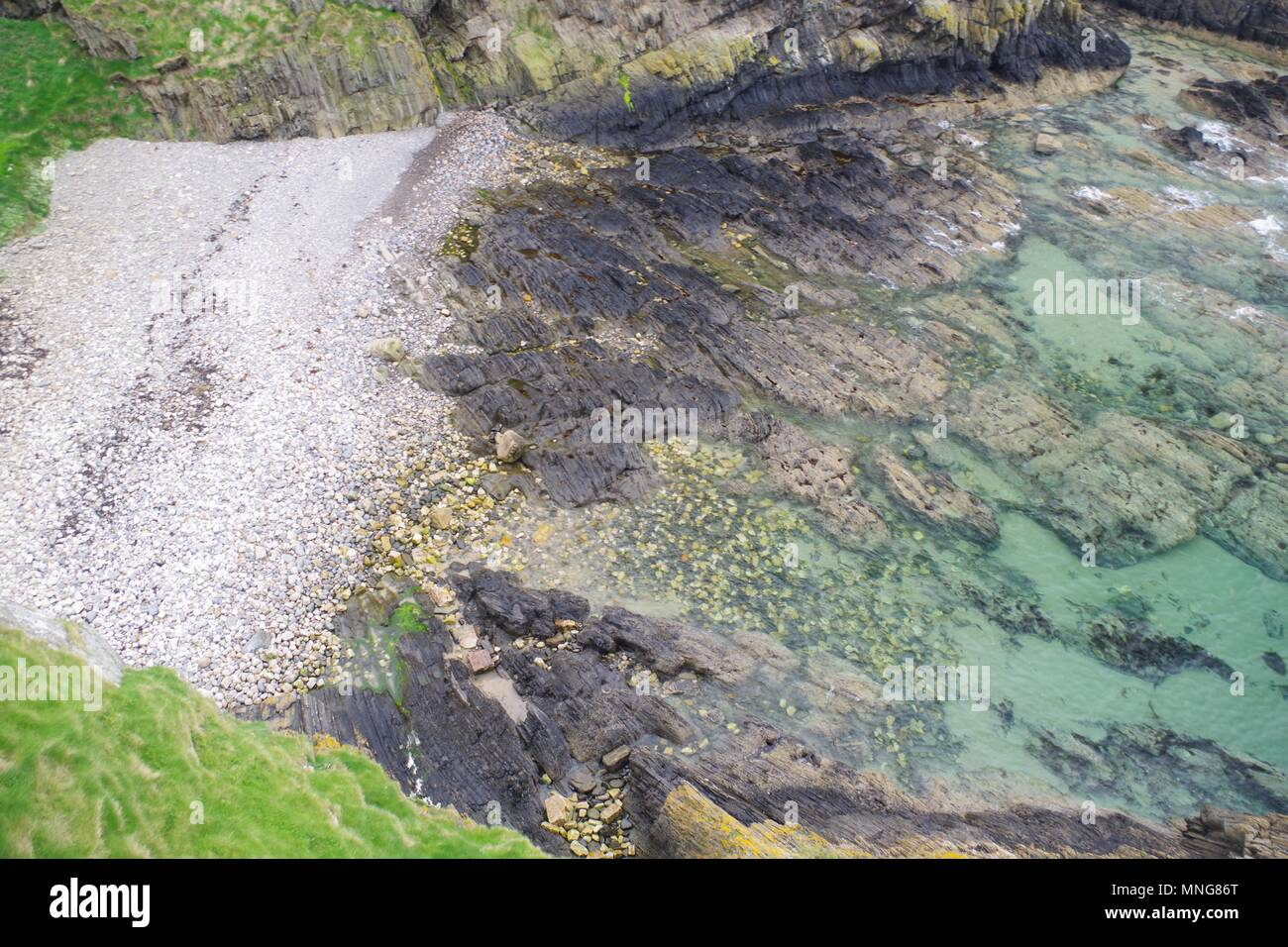 Inviting Turquoise Water of the Rugged Coast by Findlater Castle, Sanded, Scotland, UK. - Stock Image