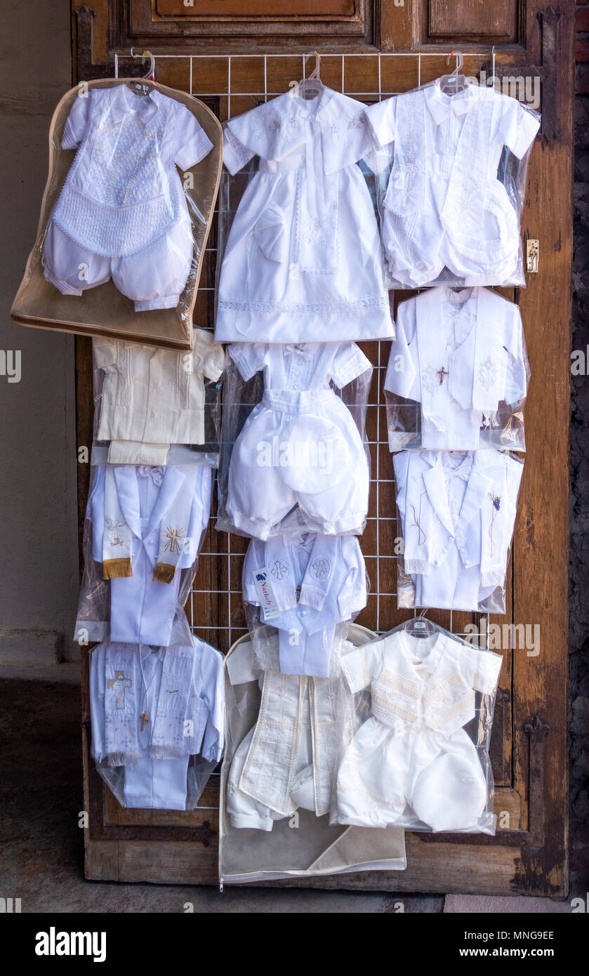Special white children's clothing for Catholic religious events - Stock Image