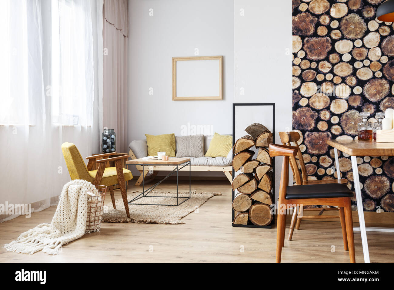 Design of multifunctional interior with natural wooden decor and minimalist modern furniture - Stock Image