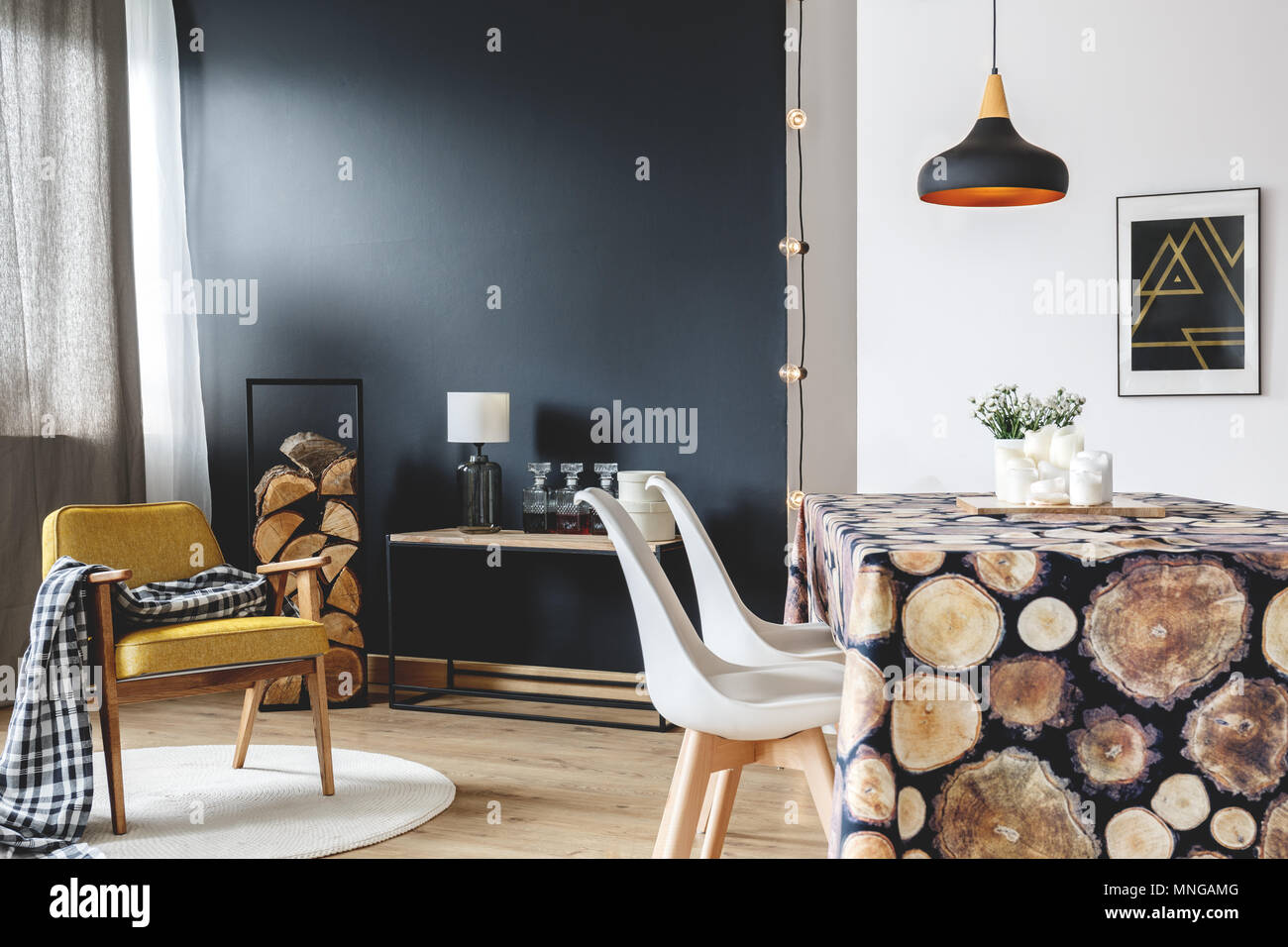 Wood design of modern interior with scandinavian furniture on black wall - Stock Image