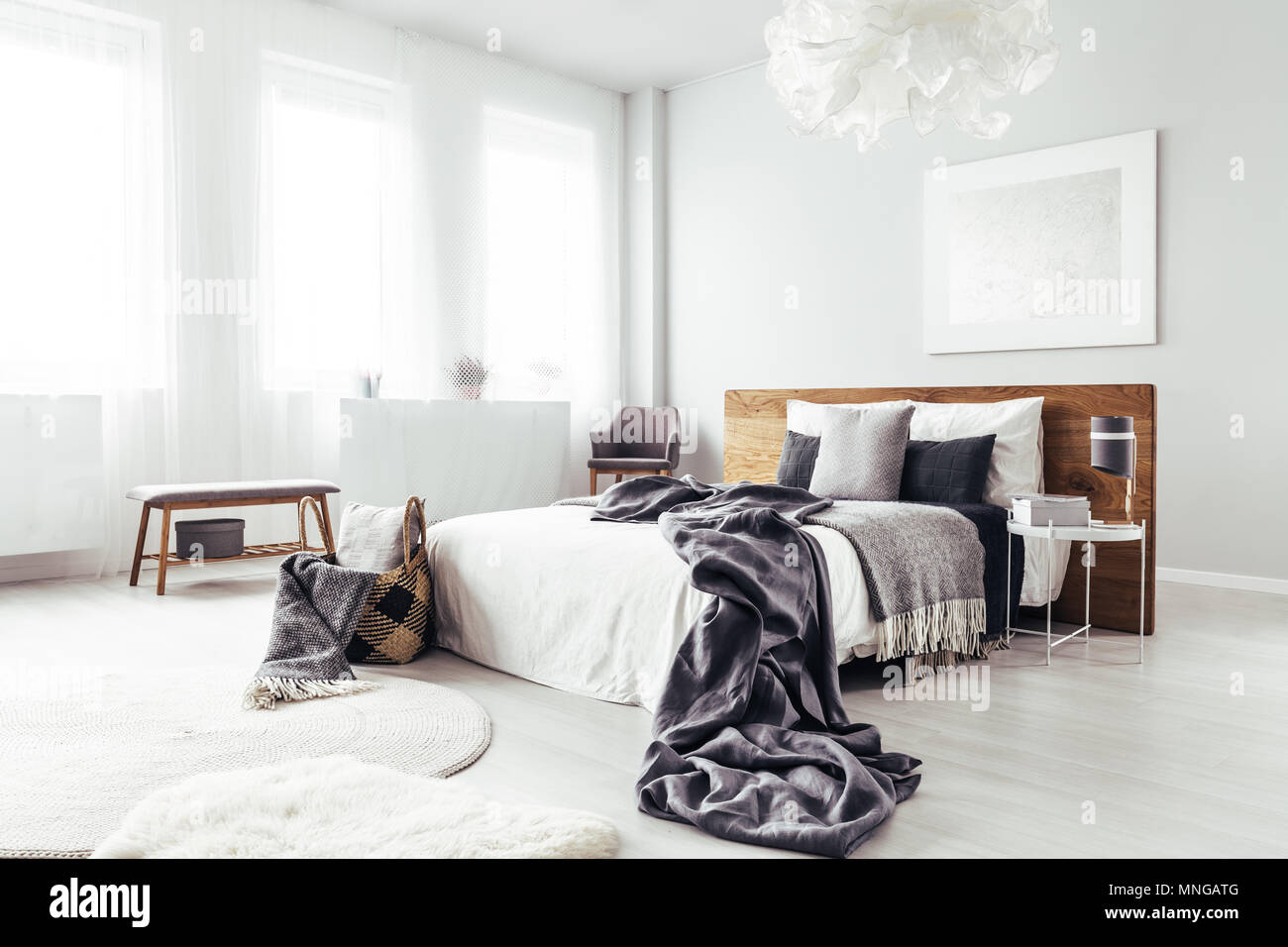 Bedsheets On King Size Bed With Wooden Bedhead In Bright Bedroom