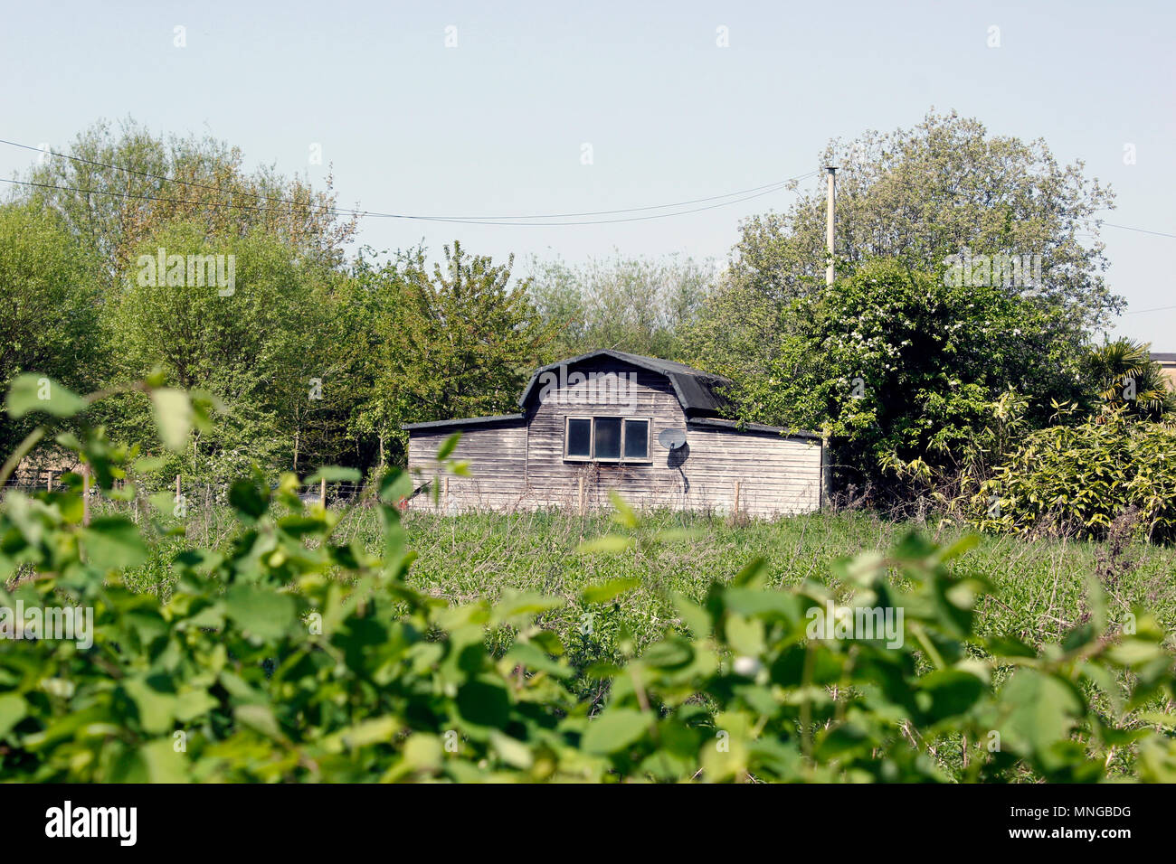 Old barn along the towpath on the river Thames at Oxford - Stock Image