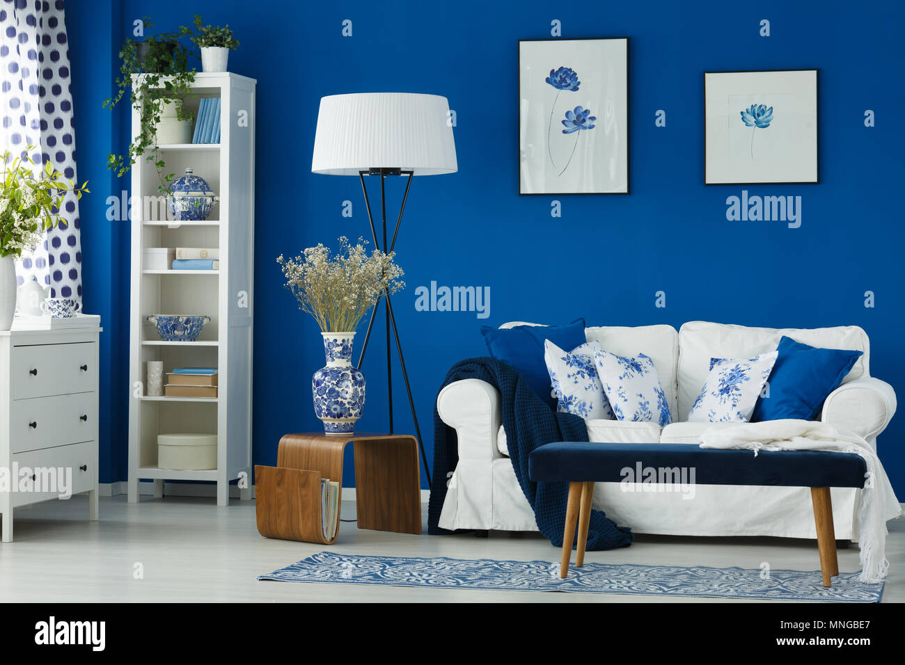 Homey stylish living room with blue walls Stock Photo