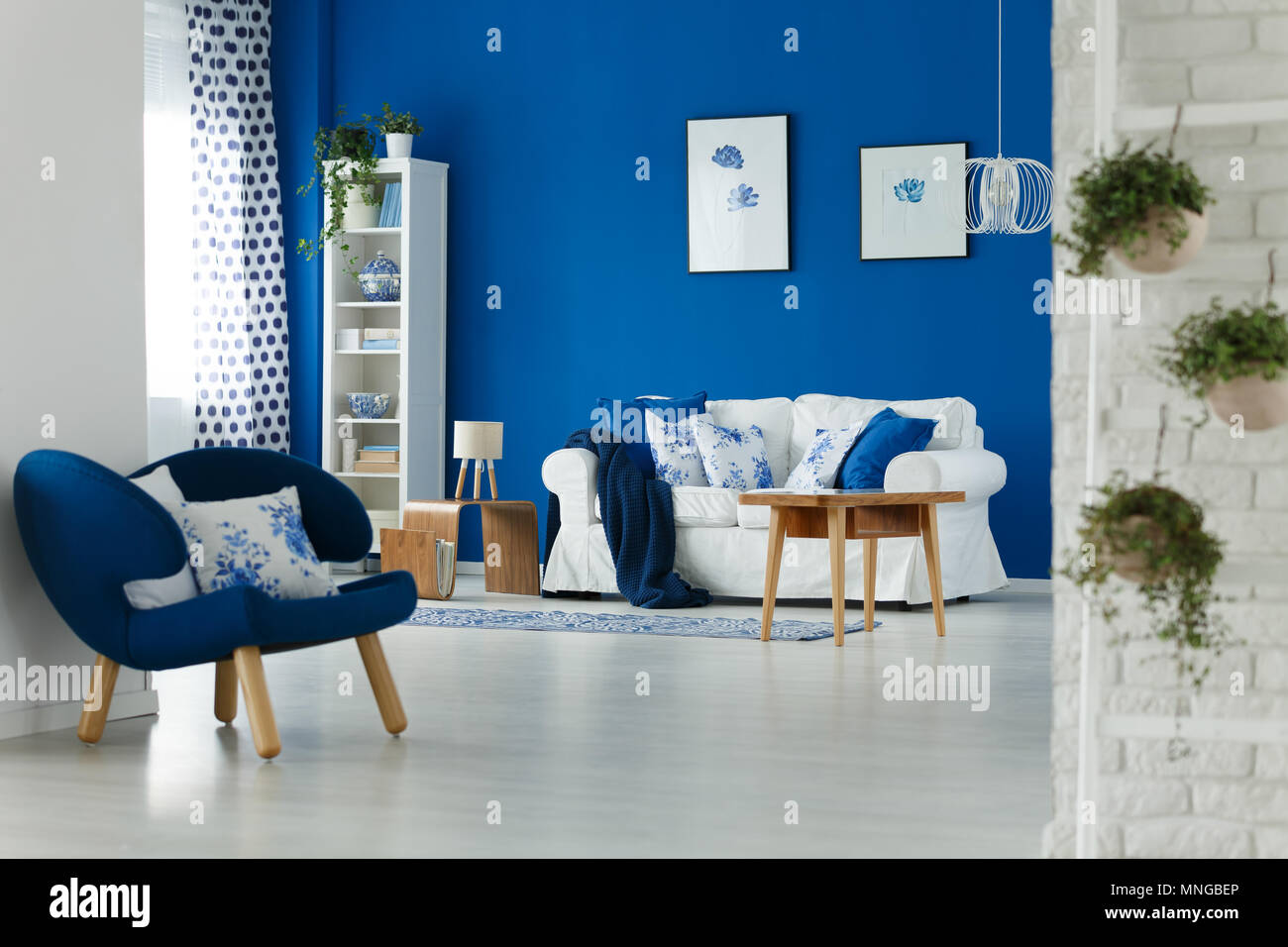 Trendy blue and white living room interior design Stock Photo - Alamy