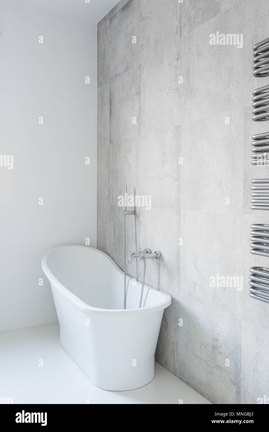 Tasteful and porcelain bathtub in the house Stock Photo: 185371819 ...