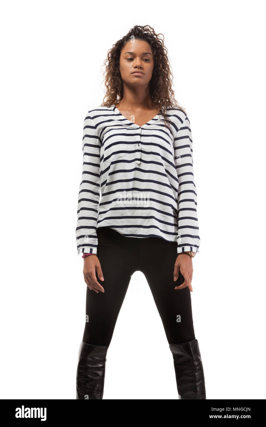 08e378aa Black girl wearing striped shirt and pants, isolated on white background