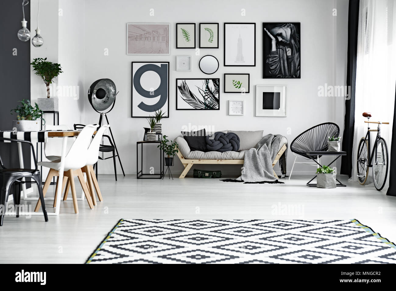 Black and white living room with posters on the wall Stock Photo ...
