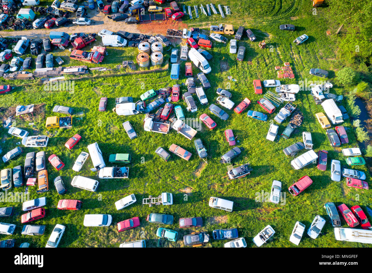 Car wrecks on meadow aerial view, ecological problem - Stock Image