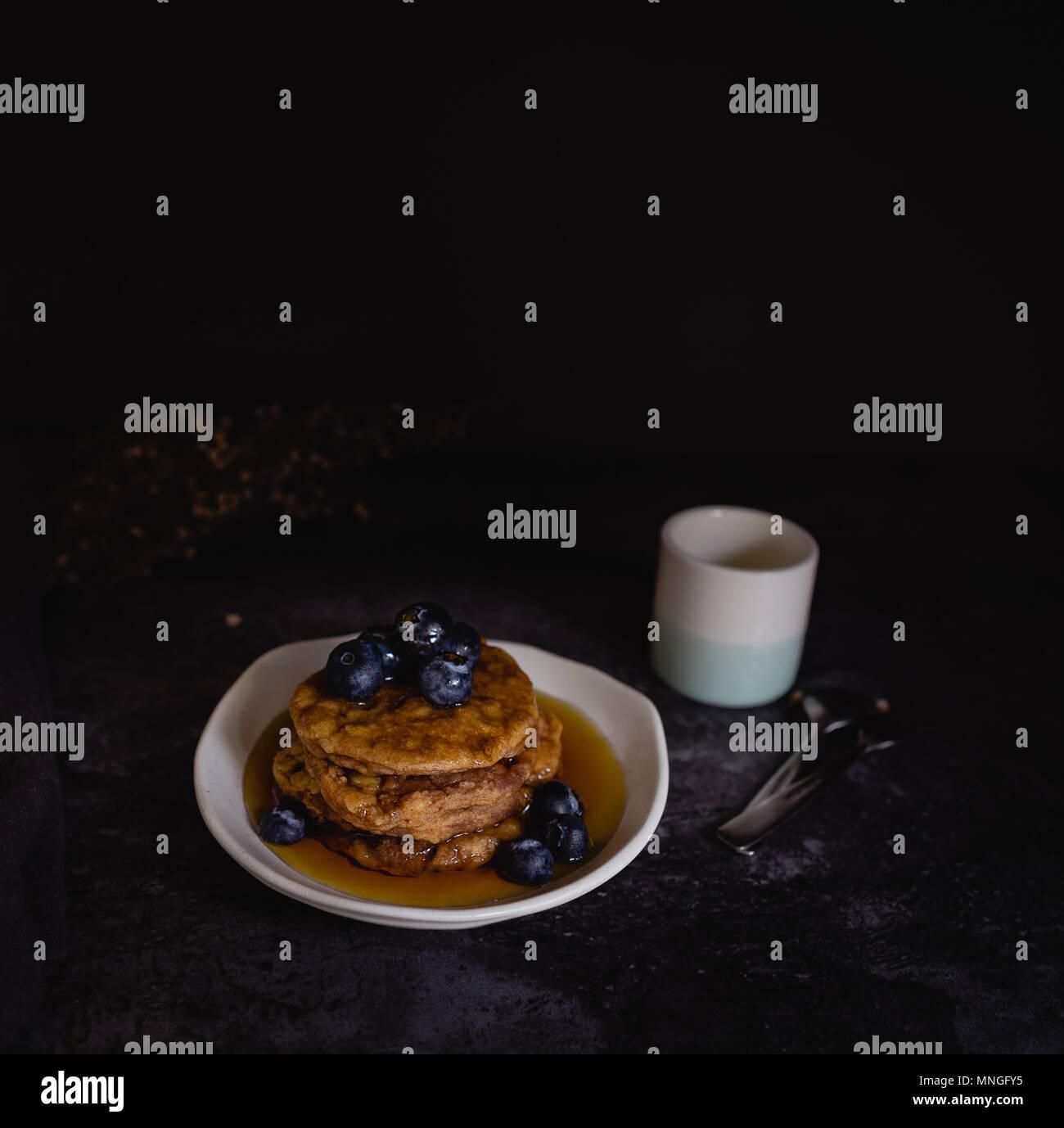 Thick Fluffy Blueberry Pancakes, Dark Background - Stock Image