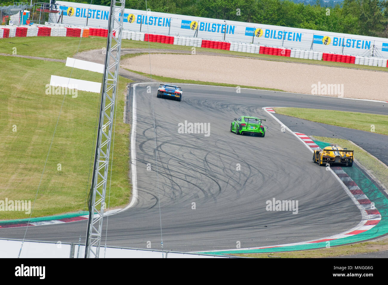 Audi R8, Porsche 911, SCG003C, Bilstein-Kurve, Nuerburgring, 24h Nuerburgring, motorsports, curves, curbes, racing, top gear, high speed, fast and fur - Stock Image