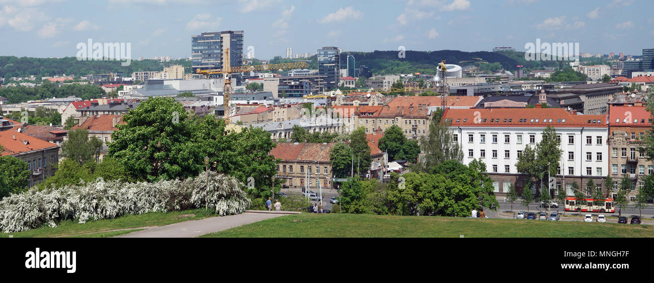 VILNIUS, LITHUANIA - MAY 16, 2018: Panorama of the spring sunny city and public garden from top of the old  Tauras mountain. Are well visible historic Stock Photo